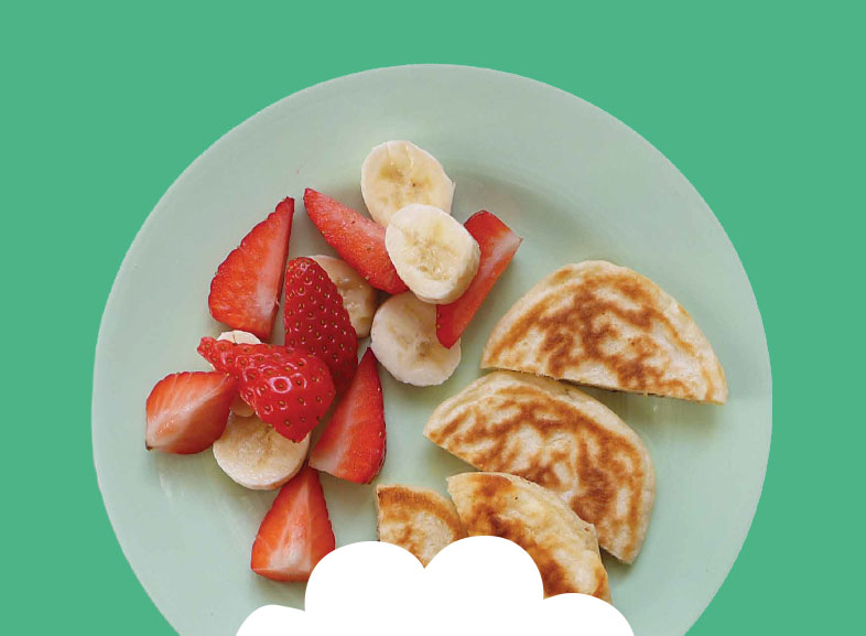Scotch pancakes with sliced banana and strawberries